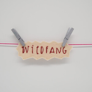 EMBROIDERED WILDFANG